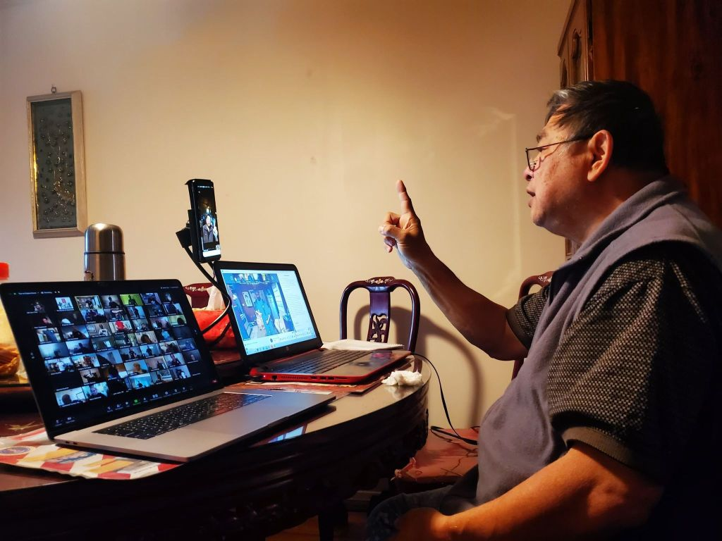 GM Sam Chin in front of his laptop